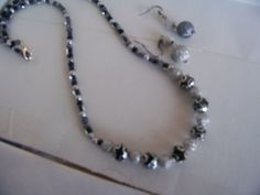 Necklace with Beads of Silver, Gray and Black with Silver Filigree Bead by kaysjewelrydesign on Etsy