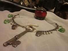 Victorian Treasure Collection Wintergreen: glass crystal and pearl necklace with antique vintage farmhouse key. $35.00, via Etsy.