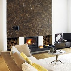 Gray Clad Fireplace Makes a Mod Statement | Fireplace surrounds ...