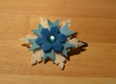 """Felt snowflake hair clip - inspired by Disney """"Frozen"""" I started by cutting out a star and it went from there, easier to make than I thought :-)"""