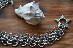 New to AthenasArmoury on Etsy: Star & Moon Celestial Steps Chain Maille Bracelet - Bright Aluminum Mesh (18.00 USD)