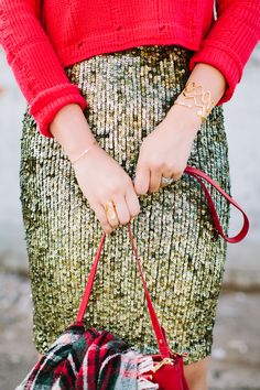 We can't dream up a more perfect Holiday glam outfit than this gold sequin skirt and red sweater.
