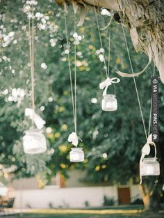 pretty hanging tea light holders topped off with bows - lovely for a rustic wedding reception | photo by Mariel Hannah | CHECK OUT MORE IDEAS AT WEDDINGPINS.NET | #weddings #weddingdecor #weddingdecoration #decor #decoration #events #forweddings