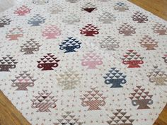 """Antique c1840s Chintz Basket Quilt, from vintageblessings on Ruby Lane, ombre blue floral, indigo blues, browns, pink, turkey red, floral, geometric, plaid, ticking, coral prints, back is small black & white leaf print, 5 spi, 77"""" x 68"""""""