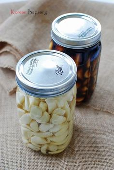 Pickled garlic (maneul jangajji – 마늘장아찌) is a staple side dish in Korea. It's one of my father's favorite dishes. Jeju Island, where my parents are from, is well … Korean Side Dishes, Garlic Recipes, Asian Recipes, Asian Desserts, Ethnic Recipes, Great Recipes, Dog Food Recipes, Delicious Recipes, Favorite Recipes