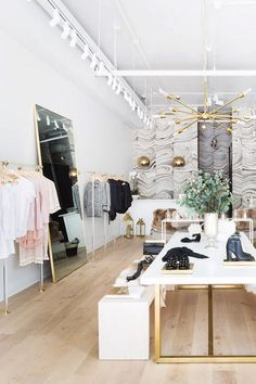 Retail space with a bright white paint color, wood floors, and gold accents