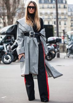 Master the latest outerwear trend started by Balenciaga and adopted by the street style set: all manner of jackets and coats worn off the shoulder.