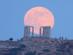 """peenutbutterprincess:  Super Moon Rises over The Temple of Poseidon """"Yesterday's view from Sounion, Greece. The visitors of the ancient Greek temple of Poseidon watch the perigee full moon rising, but i was photographing the scene from 2km (1,2 miles) at their back."""" — Elias Chasiotis The temple of Poseidon was constructed in 444-440 BC, over the ruins of a temple dating from the Archaic Period. It is perched above the sea at a height of almost 60m. The design of the temple is a typical…"""