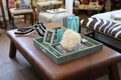 Turquoise #tray, #chevron frame and #vases are the perfect additions to this #coffee #table vignette at #Mecox #Southampton #interiordesign #MecoxGardens #Hamptons #furniture #shopping #home #decor #design #room #designidea #vintage #antiques #garden