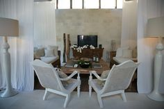 Oazia Spa Villas, Bali - The Indonesian Furniture contrasted with the white accents is a fresh modern ethnic look. Love it! Plantation chairs painted white - wow!  Check out our gallery of Indonesian furniture at gadogado.com.