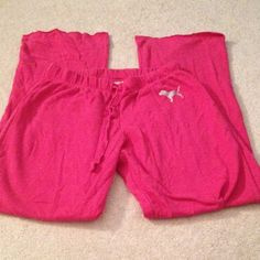 VS Pink boyfriend pants! VS Pink boyfriend pants. Hot pink with silver dog. Drawstring waist with wide leg pajama pants Victoria's Secret Pants Track Pants & Joggers