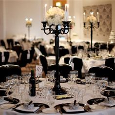 Black candelabras are a must. Don't like the flowers in a tight ball though