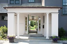 """to keep front door from over powering """"humble"""" farmhouse look, but still have sidelights to allow more light inside ... paint trim around door white like the rest of the house siding -- only paint the door, not side lights a different color"""