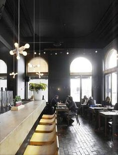 Black! Great natural light, glossy floors to reflect it, sandstone? bar and minimalist bar stools, PLUS cluster pendants. Awesome, awesome!