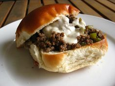 Easy Philly Cheesesteak Sandwich: 1T olive oil, 1lb ground beef, 1 med onion chopped, 1 green pepper  chopped, 2T steak sauce, 1c beef stock, Salt & Pepper, 4 dinner rolls. For cheese sauce:    1T butter, 1T flour, 1c milk & 1c shredded provolone.
