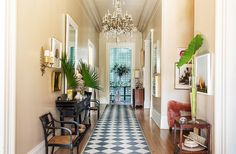 """""Entrance halls ought to set the tone at hello. This one sort of announces 'Welcome to the South'. Fresh-cut fan palms and an interior-painted trellis at…"" Design Entrée, Interior Design, Sliding Cabinet Doors, Tall Ceilings, Hallway Decorating, Decorating Ideas, Decor Ideas, Entry Hall, Love Home"