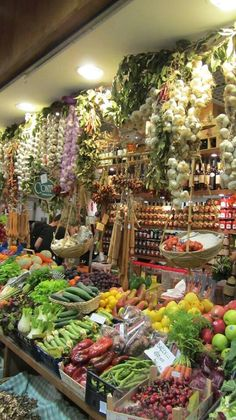 Choosing fresh produce at an Italian market and attending a cooking school.