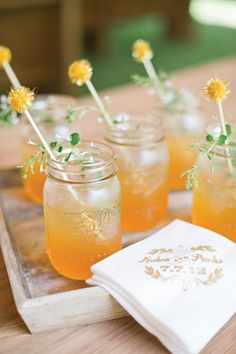 Signature drinks served in mason jars. The trailing herbs are a beautiful touch!
