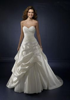 I absolutely would wear this one i just would add a little bling to it.... A-line/princess Sweetheart Neckline Ruffles Taffeta Wedding Dress