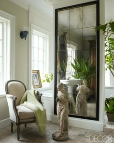 Fabulous over-sized mirror in a foyer