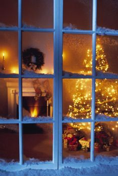 house through window | Looking through the window of a home decorated for Christmas.... More