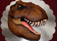 "10""carved trex cake with buttercream icing and gumpaste teeth and eye."