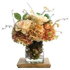 Faux hydrangea and rose arrangement in a glass vase.    Product: Faux floral arrangementConstruction Material: Silk,...