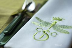 monogram and a dragonfly