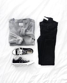 Outfit flat lay. Grey knit, black jeans, chucks.