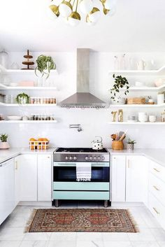 a breathtaking white kitchen with the most perfect open shelves.