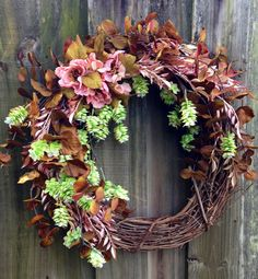 Grapevine wreath with pink and green accents that are perfect for summer. via Etsy