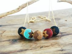 Beaded necklace - 24K gold plated - beaded beads  -  modern luxury, geometric, ruby, black, gold turquoise. Contemporary, modern jewelry on Etsy, $75.00