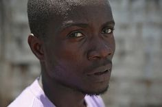 Mohammed Wah, 23, stands in the low-risk section of the Doctors Without Borders (MSF), Ebola treatment center on October 16, 2014 in Paynesville, Liberia. The construction worker said that Ebola killed 5 members of his extended family and he thinks he contracted the disease while caring for his nephew