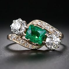 Antique Emerald and Diamond Ring features a cushion-cut emerald of 1.13 carats and two European-cut diamonds totalling 1.20 carats in Platinum and 18k Rose Gold, circa 1890. (=)