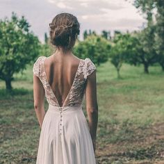 wedding dress Bohemian lace short sleeved top wedding dress with deep v back and buttons.Bohemian lace short sleeved top wedding dress with deep v back and buttons. Parisian Wedding Dress, Boho Wedding Dress With Sleeves, Top Wedding Dresses, Bohemian Wedding Dresses, Wedding Gowns, Lace Dress, Short Sleeved Wedding Dress, Bohemian Bride, Lace Wedding