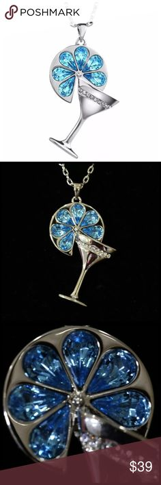"""Swarovski Blue Crystal Martini Glass Necklace ‼️PRICE FIRM‼️   Swarovski Crystal Necklace  Retail $118  To say that this is a spectacular necklace would be an understatement. Beautifully & skillfully handcrafted from the finest Swarovski crystals with a 14K gold overlay. Necklace is approximately 18.5"""". Charm section is approximately 1.7"""".  Please check my closet for many  more items including designer clothing, Handmade Jewelry Necklaces"""