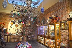 The wrought iron tree in the Plaza Gift shop always has many hand crafted ornaments on display. Plaza Hotel Las Vegas, Las Vegas Hotels, New Mexico, Wrought Iron, Display, Gifts, Nyc, Painting, Ornaments