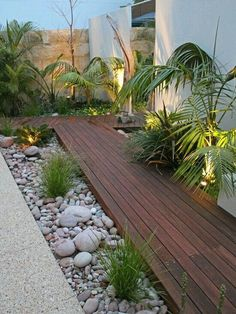 Surround garden path decks with river rocks and grasses to integrate them seamlessly into your yard.