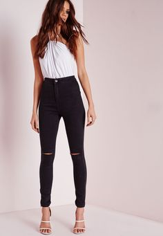 We're totally crushin' on these black high waisted beauts. These skinny jeans come in a super soft stretch finish which creates a flattering fit and sexy silhouette, and ripped knee detailing. Team up with a white bodysuit, heeled sandals a...