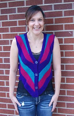 FREE. Bold, bright stripes with a solid color back make this vest a fun accessory.