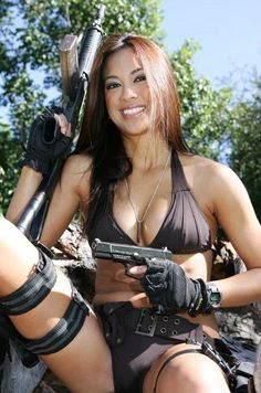 Appears to be properly trained in trigger safety.  Girls with guns also use GunRightsAttorneys.Com