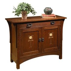 Solid hardwood in oak or cherry with inlay and available in many finishes, small scaled chest with two doors and shelf. Can be ordered at any of our Chicago stores.