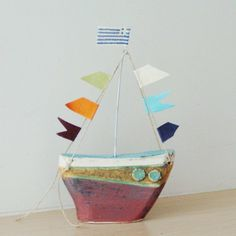 Ceramic sailing boat with colourful flags, stoneware clay boat sculpture with wire mast and fabric flags, Greek pottery boat Summer Crafts, Diy And Crafts, Arts And Crafts, Greek Flag, Greek Pottery, Stoneware Clay, Cozy House, Sailing Boat, Christmas Crafts
