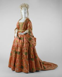 The late 1670s saw a new development in the style of women's dress that would have a far-reaching effect throughout the following century. The stiff constricting boned bodice-and-skirt style previously worn by women was now replaced with the mantua, a more loosely draped style of gown