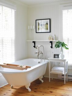 love the tub, telephone shower ~ really like the wood tray resting on the tub...could try to make this ~ from Photo Gallery: Traditional Cottages | House & Home