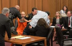 Victim's dad tormented in court: Lunges at daughter's smirking serial killer