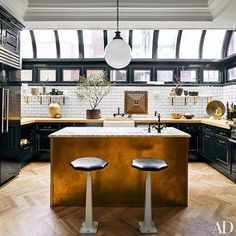 At the Manhattan apartment of designers Nate Berkus and Jeremiah Brent, the kitchen is outfitted with cabinetry and butcher-block countertops. Classic Kitchen, New Kitchen, Kitchen Dining, Kitchen Decor, Kitchen Ideas, Brass Kitchen, Kitchen Black, Kitchen Interior, Kitchen Inspiration