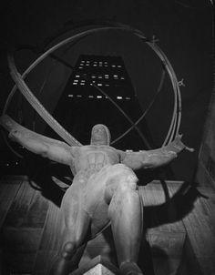 Statue of Atlas standing in front of office building in Rockefeller Center during dim out.  Location:New York, NY, US  Date taken:April 1942