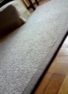 Homemade Rug!  You'll Need: A carpet remnant and durable fabric for boarder.