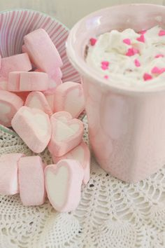 Heart shaped marshmallows with whipped cream and hot chocolate